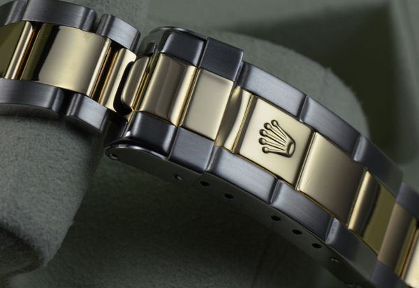 Từ Điển Thuật Ngữ Để Chơi Đồng Hồ Rolex Thụy Sỹ Chính Hãng Gold through clasp